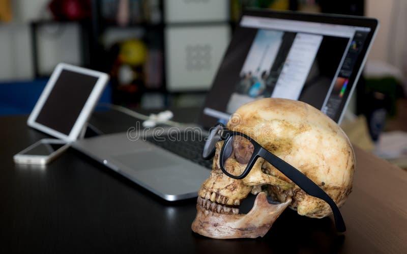 Dead business man skull on office stock photos