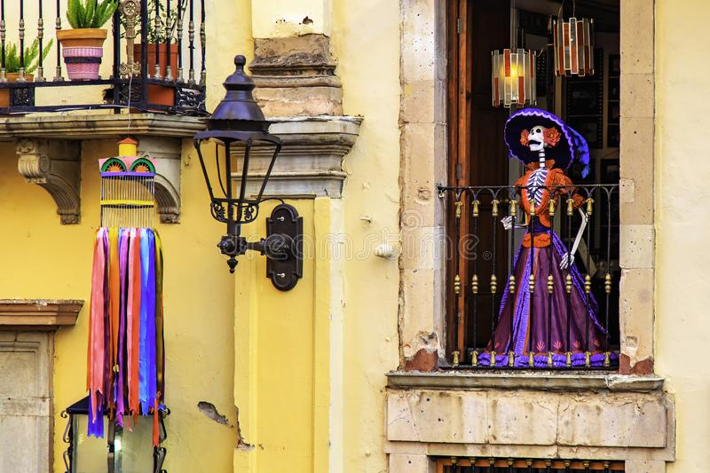 Day of the death. Traditional Mexican Catrina at the window of the old historic building, Guanajuato, Mexico. An. Dead Catrina is An elegantly-dressed skeleton royalty free stock photo