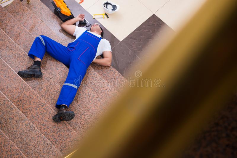 The dead contractor worker felling off the stairs stock image