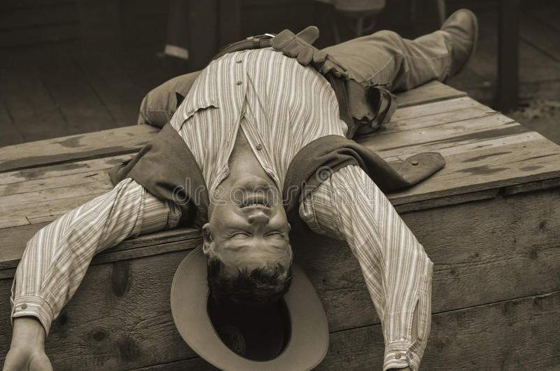 Dead Cowboy. A scene from a staged cowboy fight gunfight at Deadwood town stock photos