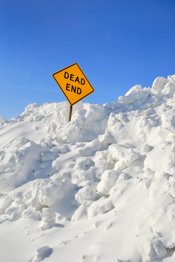 Dead End. Sign in pile of snow stock photography