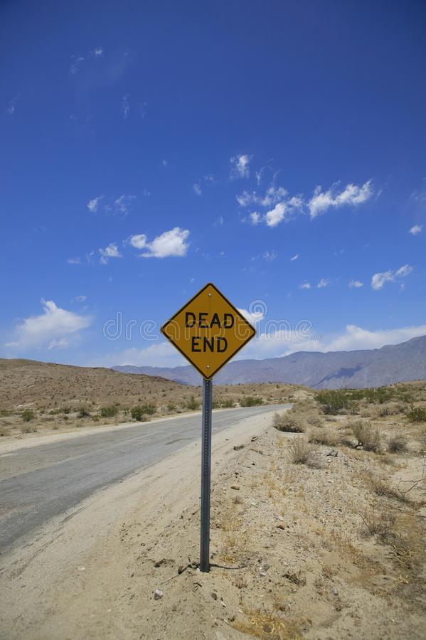 Dead end. Sign in the desert with blue sky royalty free stock photography