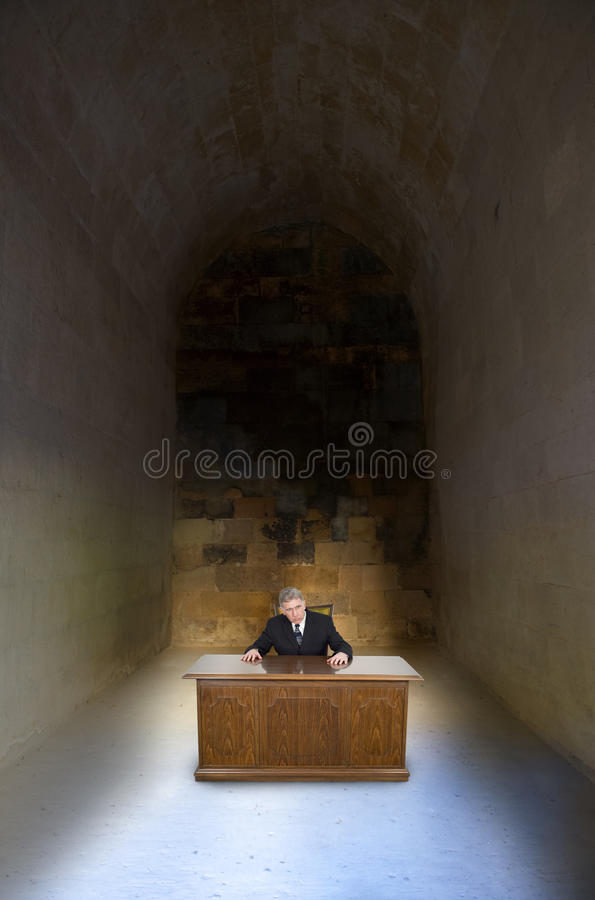 Dead End Job Bad Career Concept Businessman. Abstract concept and metaphor for a businessman in a dead end job or bad business career. The man is sitting at a stock photography