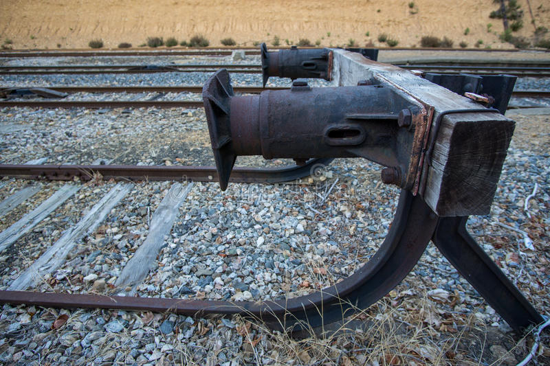 Dead end of a railway train, side view. Wide angle view of dead end of a railway, closeup, shallow depth of field stock image