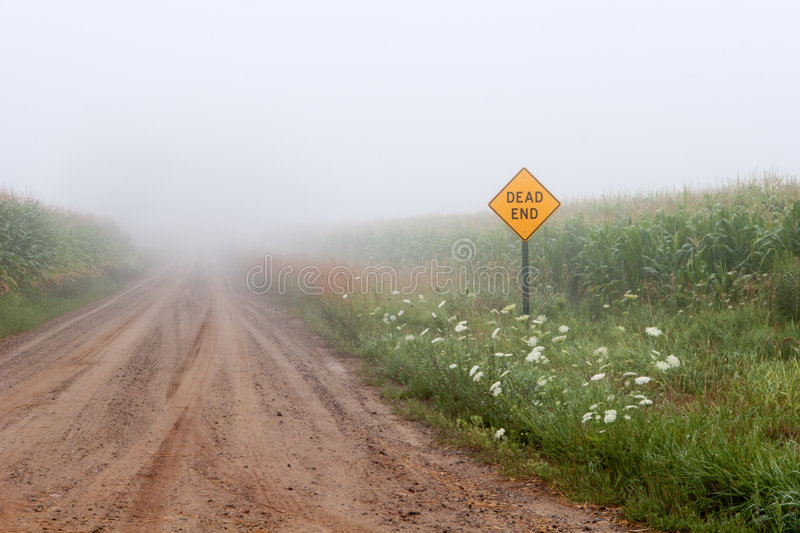 Dead End Road. Foggy morning on an old country dead end road stock image