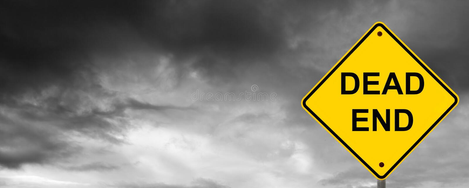 Dead End Sign. With dark storm clouds behind royalty free stock photo