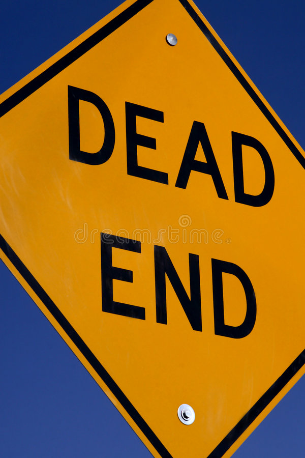 Dead End Sign. A dead end sign against a blue sky royalty free stock photo