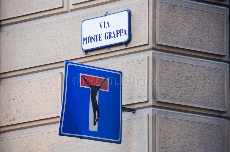 Dead end street sign with a self made crucifix. In Italy, religious implication royalty free stock photos