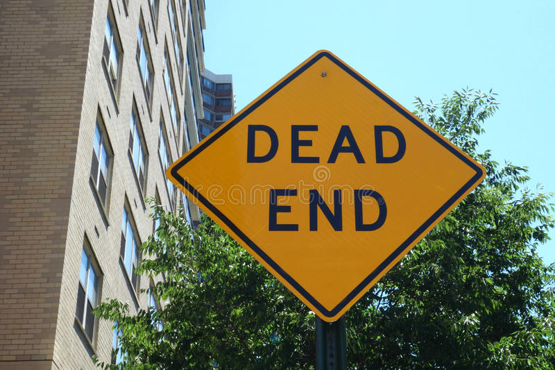 Dead End. A yellow traffic sign indicating a dead end stock photo
