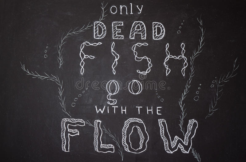 Only dead fish go with the flow. Motivational proverb. Hand drawn with chalk on dusty blackboard vector illustration