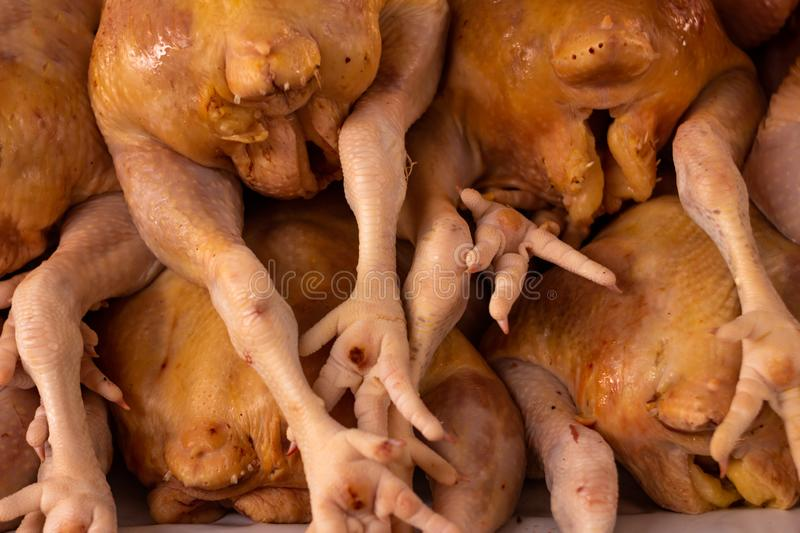 Dead hens on a table. Numerous legs together in the market. White meat for human consumption. Dead hens on a table. Numerous legs together in the market. White royalty free stock images