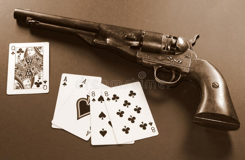 Dead Man's Hand - Sepia. The famous Dead Man's Hand a poker hand of aces and eights held by Wild Bill Hickok when he was murdered. Above the cards is a army stock images