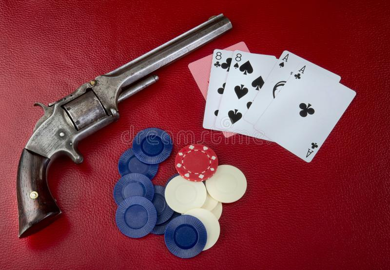 Dead Mans Hand. Dead mans hand aces and eights with Wild Bill`s six shooter stock photos
