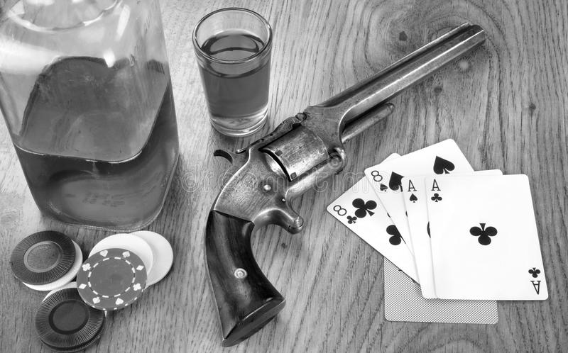 Dead Mans Card Hand. Dead mans hand aces and eights with Wild Bill`s six shooter in black and white royalty free stock photography