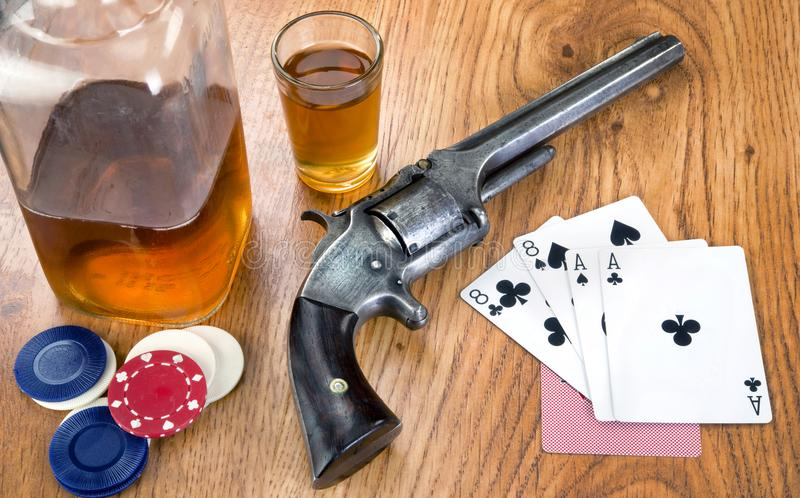 Dead Mans Card Hand. Dead mans hand aces and eights with Wild Bill`s six shooter royalty free stock photos
