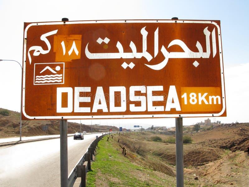 Dead sea information board. Dead sea info roadside bilingual board stock photos