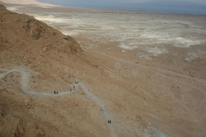 Dead Sea During Winter Showing Hiking Trail up to Masada stock images