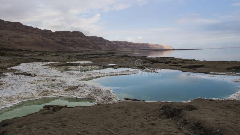 Dead sea Sinkholes at the lowest place in the world. The Dead sea, the lowest place in the world, -424m below se level , Ein Gedi, the border between israel and stock image