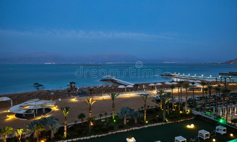 Dead Sea, is a salt lake bordering Jordan to the north, and Israel to the west. Its surface and shores are 430.5 metres 1,412 ft below sea level. Evening shot stock images