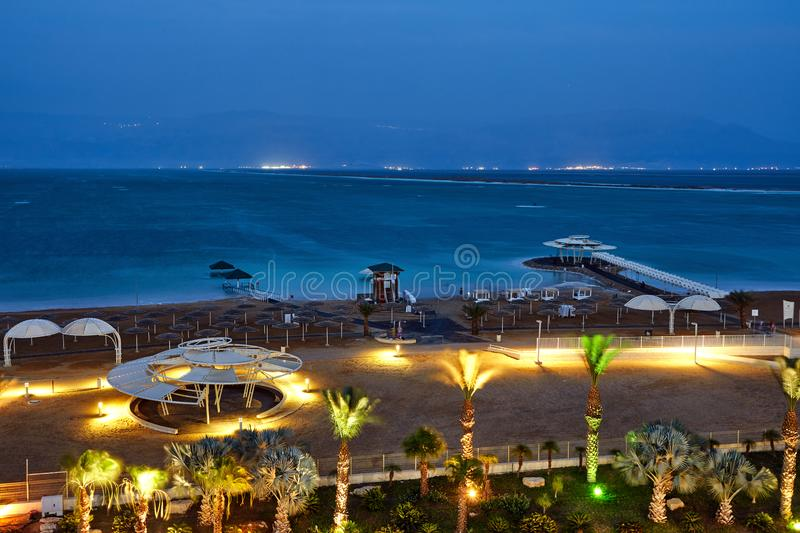 Dead Sea, is a salt lake bordering Jordan to the north, and Israel to the west. Its surface and shores are 430.5 metres 1,412 ft below sea level. Evening shot royalty free stock image