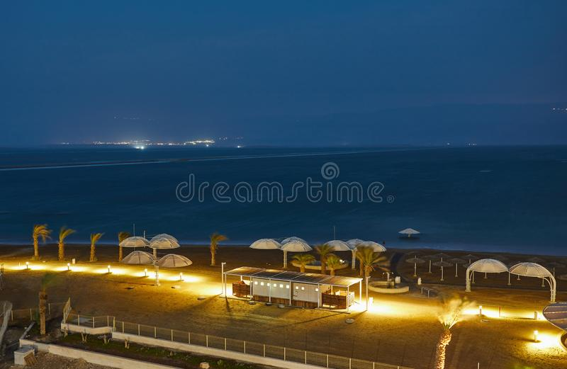 Dead Sea, is a salt lake bordering Jordan to the north, and Israel to the west. Its surface and shores are 430.5 metres 1,412 ft below sea level. Evening shot royalty free stock photos