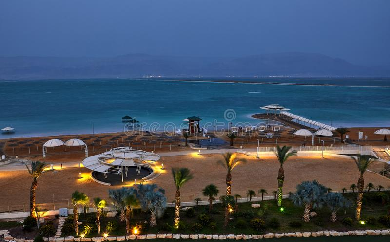 Dead Sea, is a salt lake bordering Jordan to the north, and Israel to the west. Its surface and shores are 430.5 metres 1,412 ft below sea level. Evening shot stock image