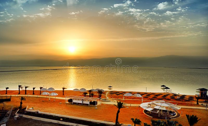 Dead Sea, is a salt lake bordering Jordan to the north, and Israel to the west. Its surface and shores are 430.5 metres 1,412 ft below sea level. Sunrise by royalty free stock photography