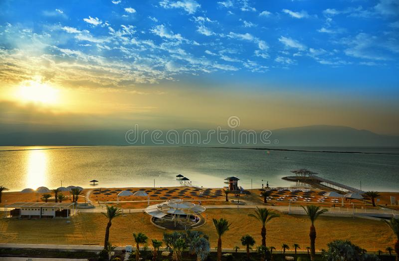 Dead Sea, is a salt lake bordering Jordan to the north, and Israel to the west. Its surface and shores are 430.5 metres 1,412 ft below sea level. Sunrise by stock image