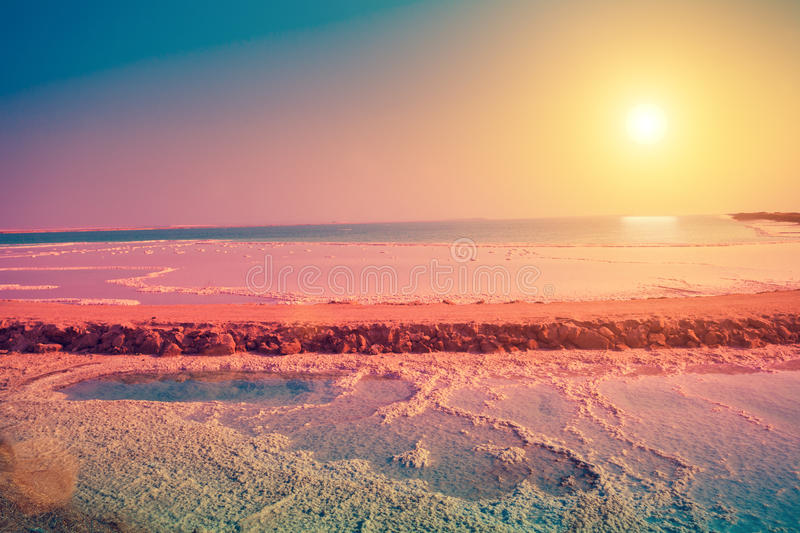 Dead sea salt shore. At sunrise royalty free stock images