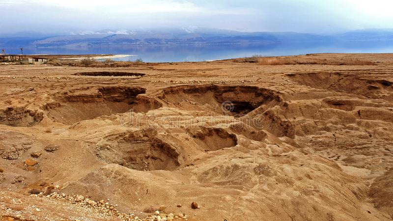Dead sea Sinkholes at the lowest place in the world. The Dead sea, the lowest place in the world, -424m below se level , Ein Gedi, the border between israel and royalty free stock images