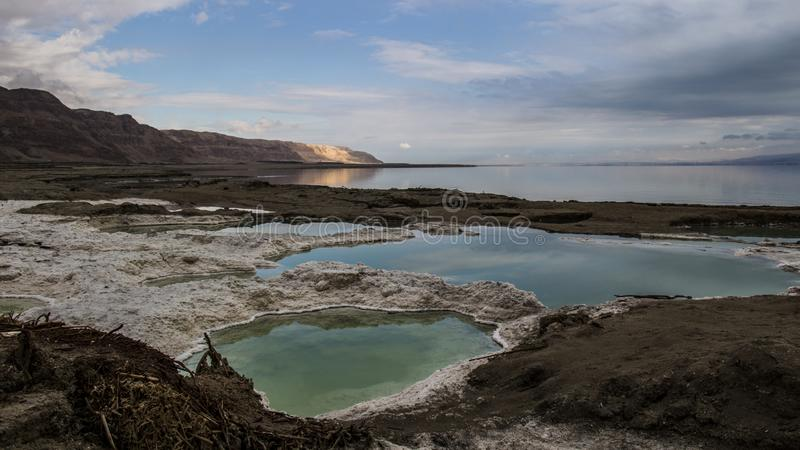 Dead sea Sinkholes at the lowest place in the world. The Dead sea, the lowest place in the world, -424m below se level , Ein Gedi, the border between israel and royalty free stock photography