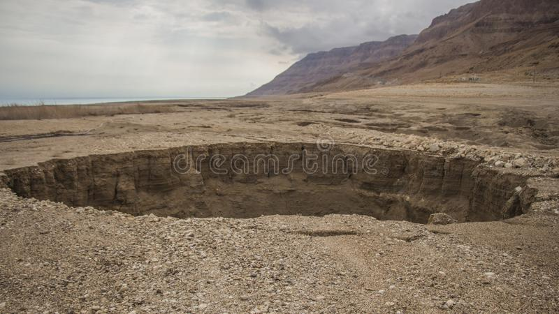 Dead sea Sinkholes at the lowest place in the world. The Dead sea, the lowest place in the world, -424m below se level , Ein Gedi, the border between israel and stock images