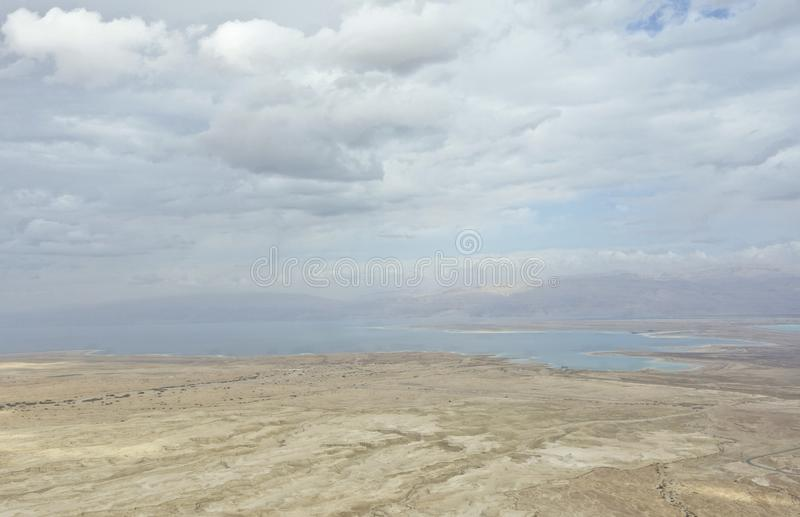 Dead Sea During Winter with Clouds from Masada Hilltop. Panorama of Dead Sea in Israel is the sea of salt; it`s 1,400 feet below sea level. It`s almost 10X stock photos