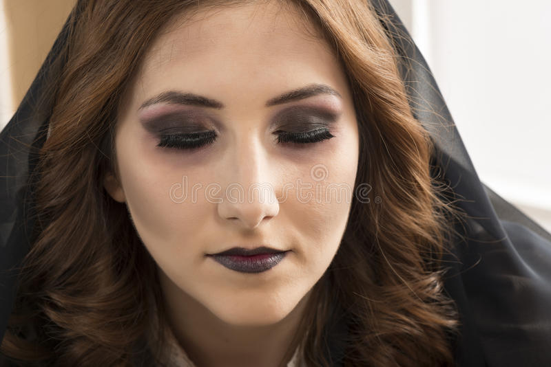 Dead widow in grief. Young beautiful demonic female. Dark Beautiful Gothic Princess.Halloween party royalty free stock photo