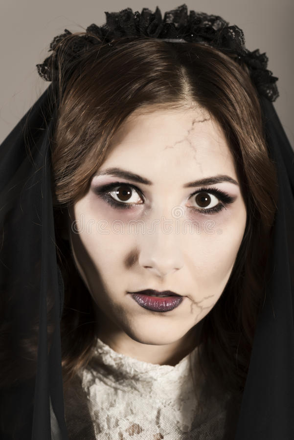 Dead widow in grief. Young beautiful demonic female. Dark Beautiful Gothic Princess.Halloween party stock images