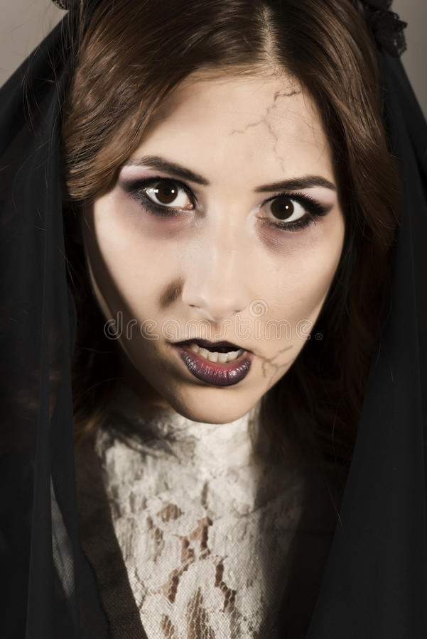 Dead widow in grief. Young beautiful demonic female. Dark Beautiful Gothic Princess.Halloween party royalty free stock image
