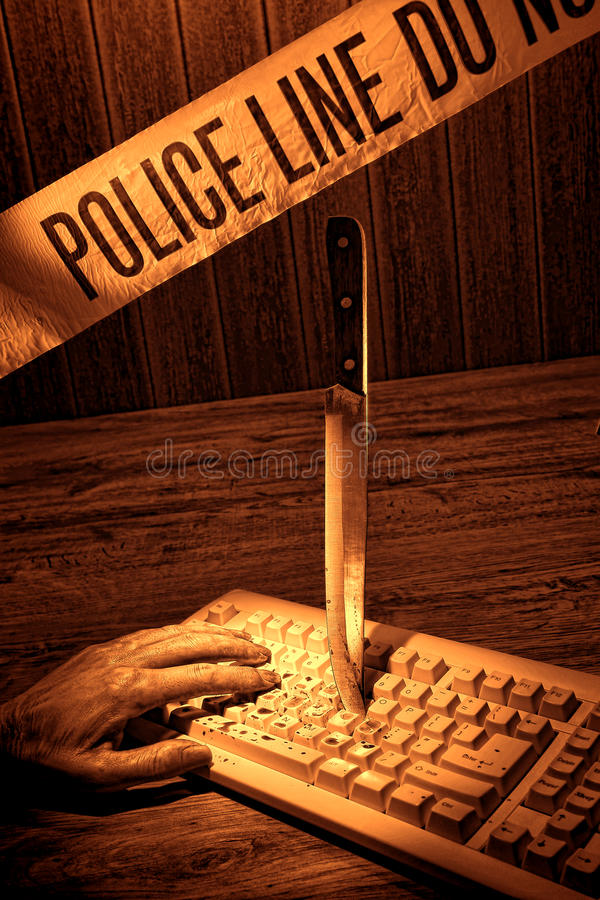 Dead Woman Hand on Computer Keyboard Crime Scene stock photo