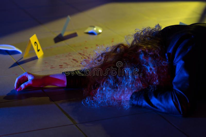 Dead woman lying on the floor stock photo