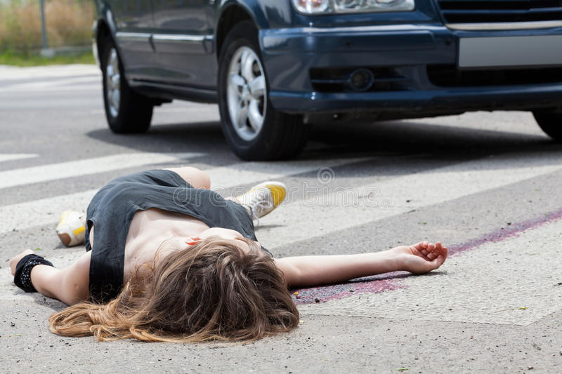Dead woman lying on a street royalty free stock photography