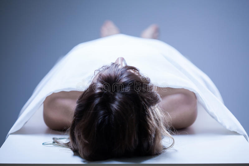 Dead woman in the morgue royalty free stock images