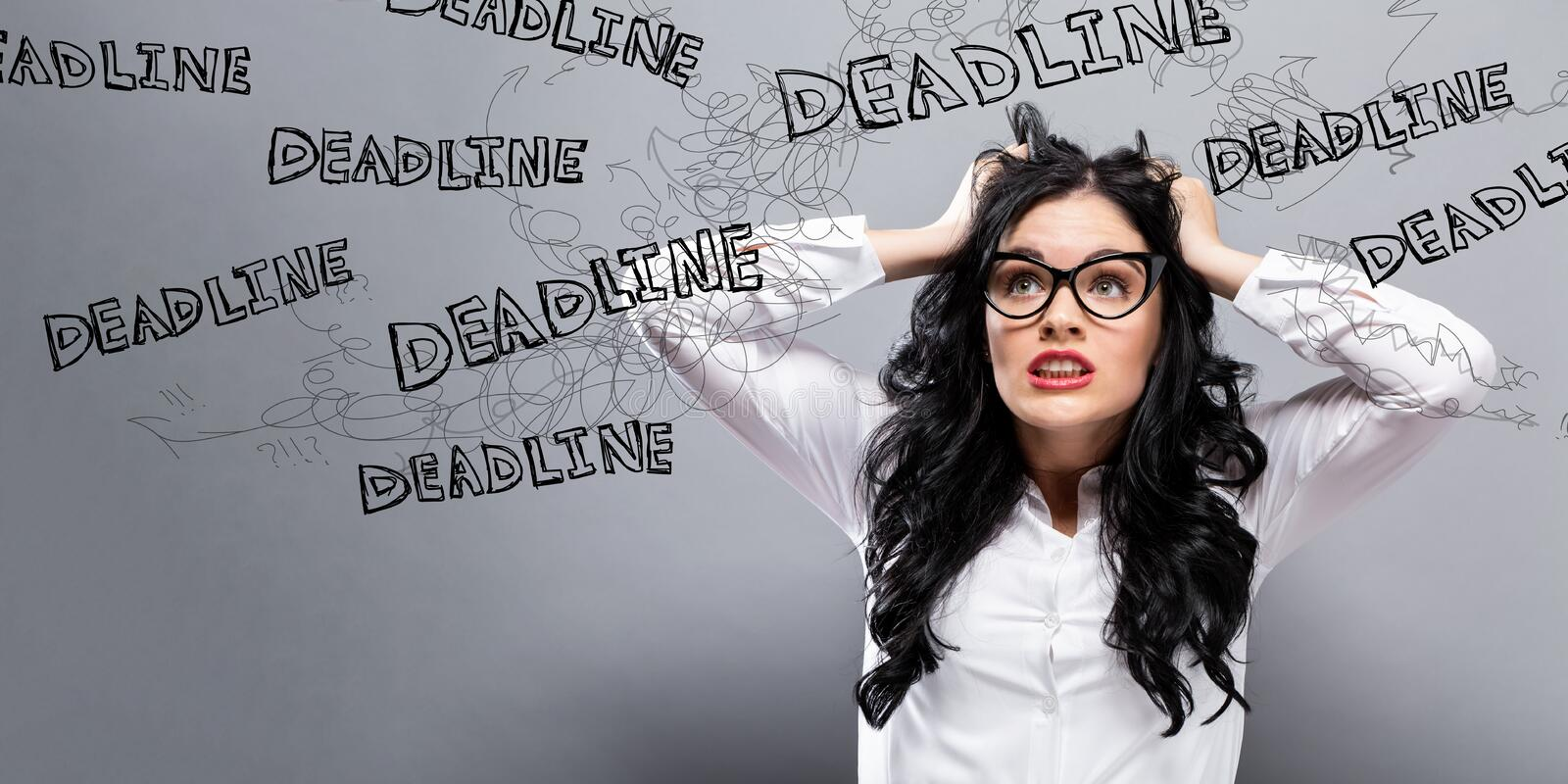 Deadline with business woman feeling stressed stock photo