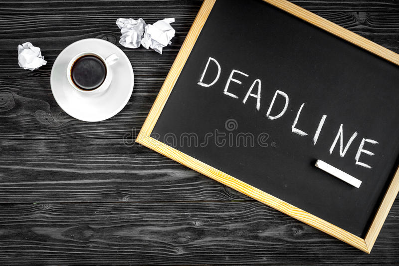 Deadline concept on dark wooden background top view.  royalty free stock photo