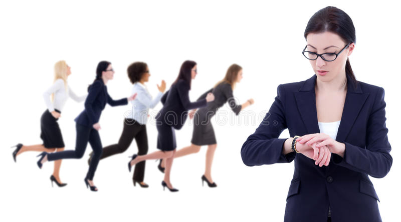 Deadline concept - young business woman checks time on wrist watch and her running colleagues isolated on white. Deadline concept - young business women checks stock photos