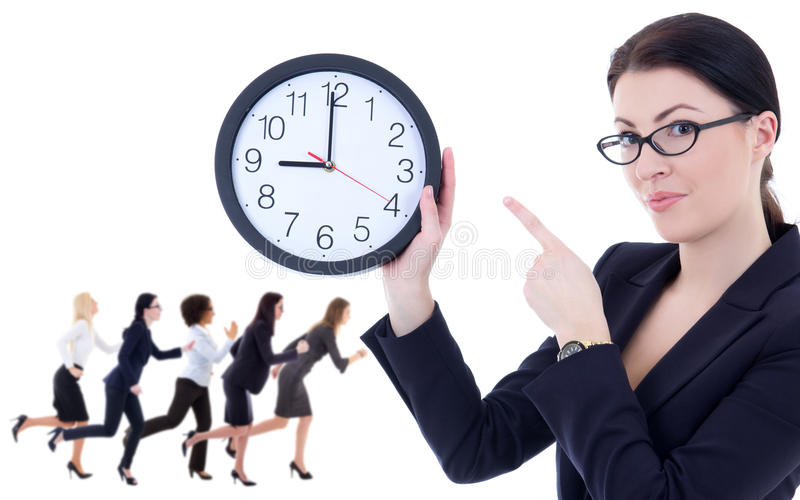 deadline concept - young woman holding office clock and her running colleagues isolated on white royalty free stock photo