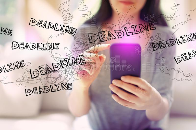 Deadline with woman using a smartphone royalty free stock photos
