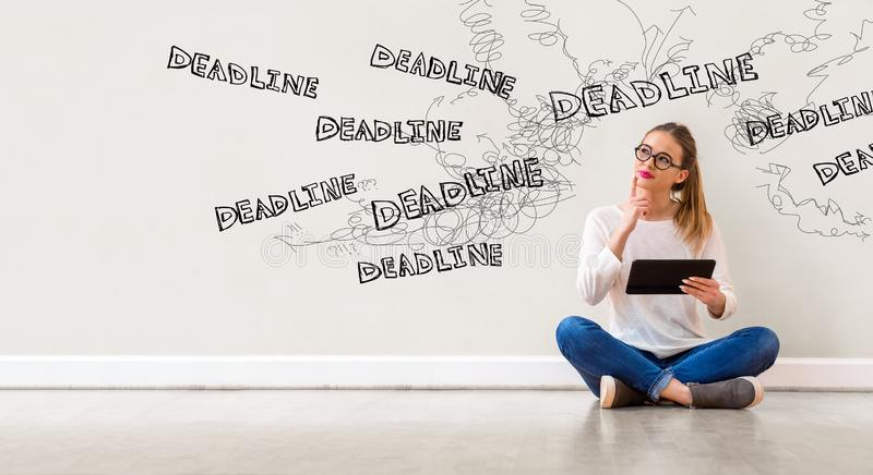 Deadline with woman using a tablet royalty free stock images