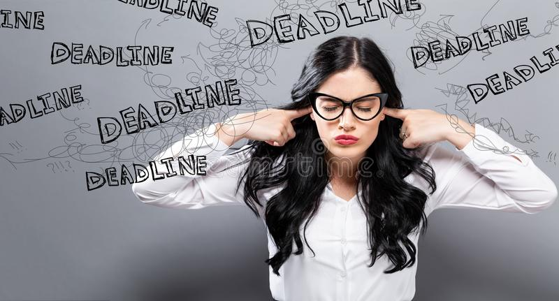 Deadline with business woman feeling stressed stock photos