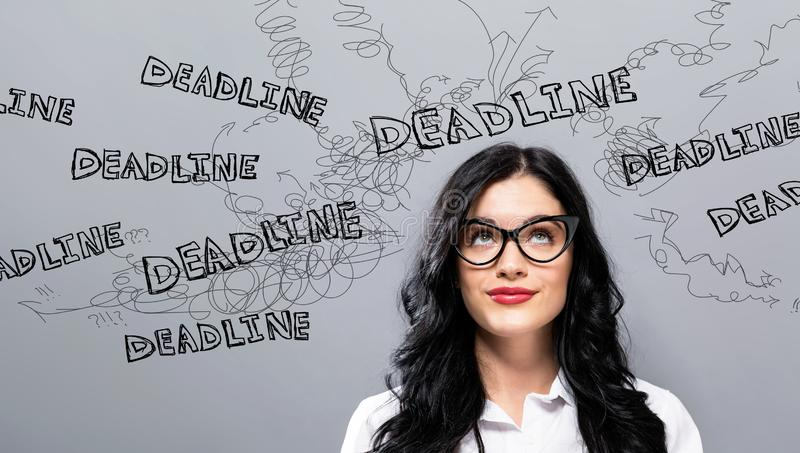 Deadline with young businesswoman. In a thoughtful face stock image