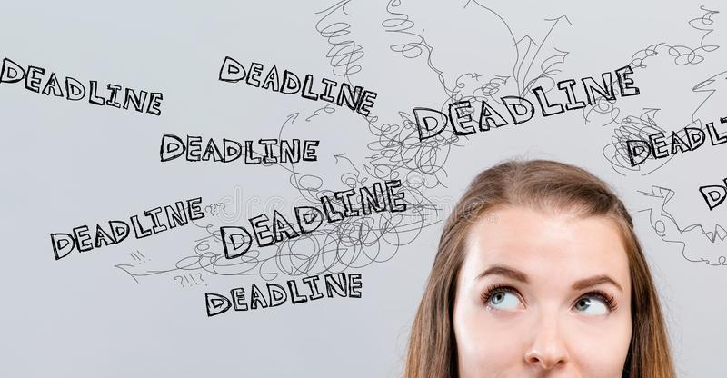 Deadline with young woman royalty free stock photography