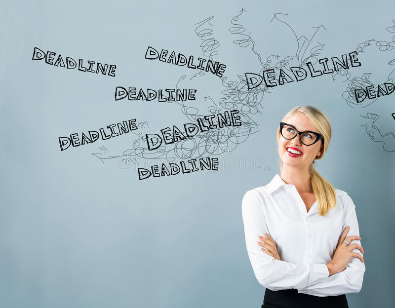 Deadline with young woman stock photo